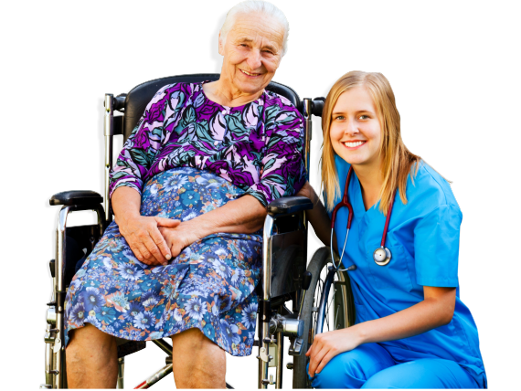 An elderly sitting on a wheelchair accompanied by her caregiver